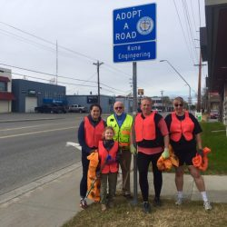 Alissa Pempek, Rudder St. Croix, Keith Guyer, Jay Hermanson, and Suzanne Taylor pose with our Adopt-A-Road sign before heading out to pick up trash on Arctic Blvd.